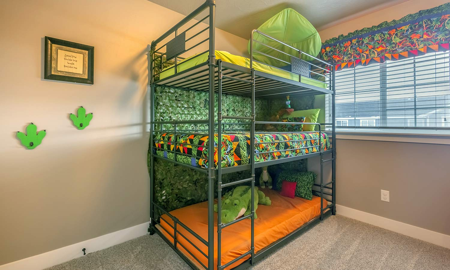 A bunk bed with three beds stacked on top of each other