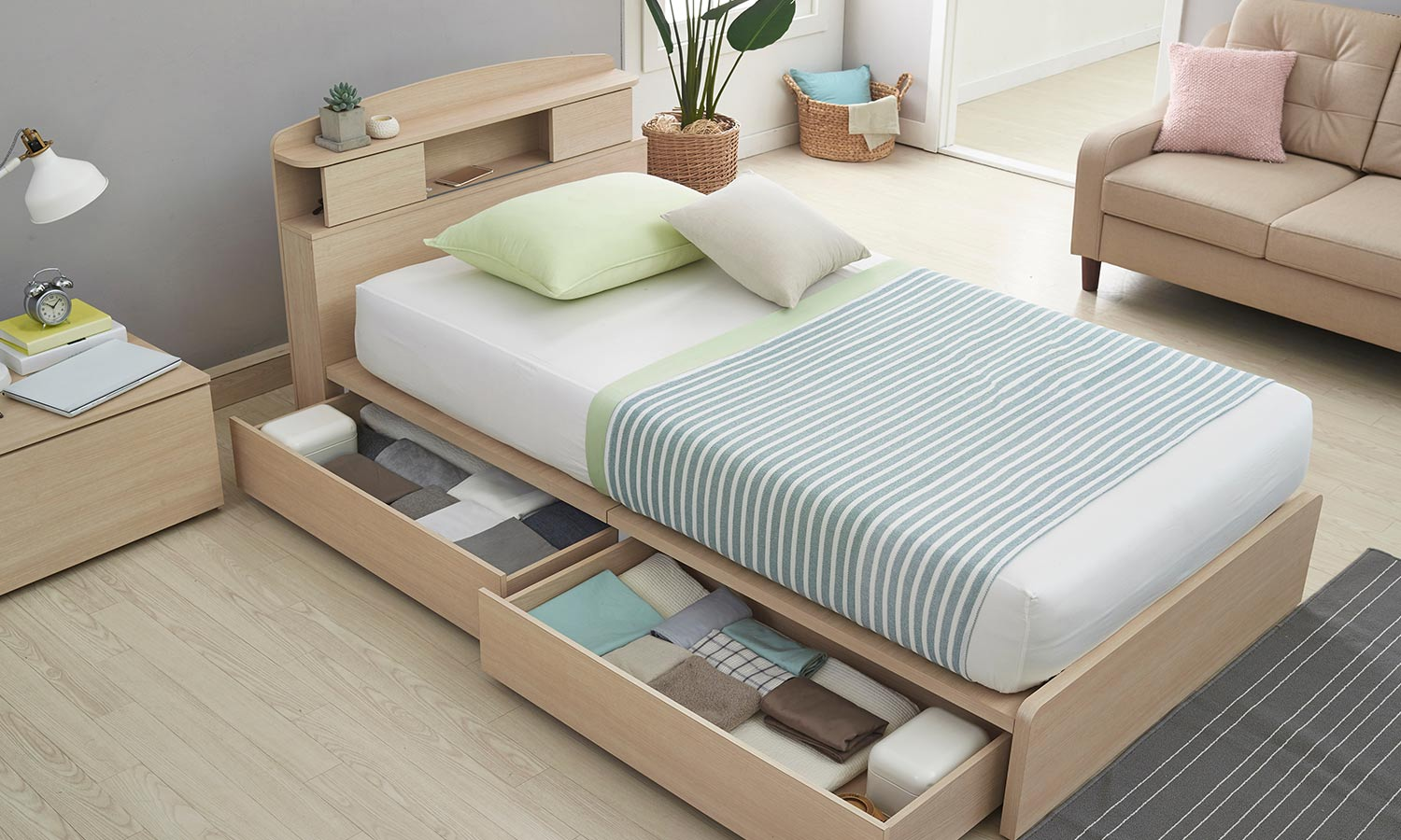 A twin bed with pullout drawers underneath. The drawers are full of