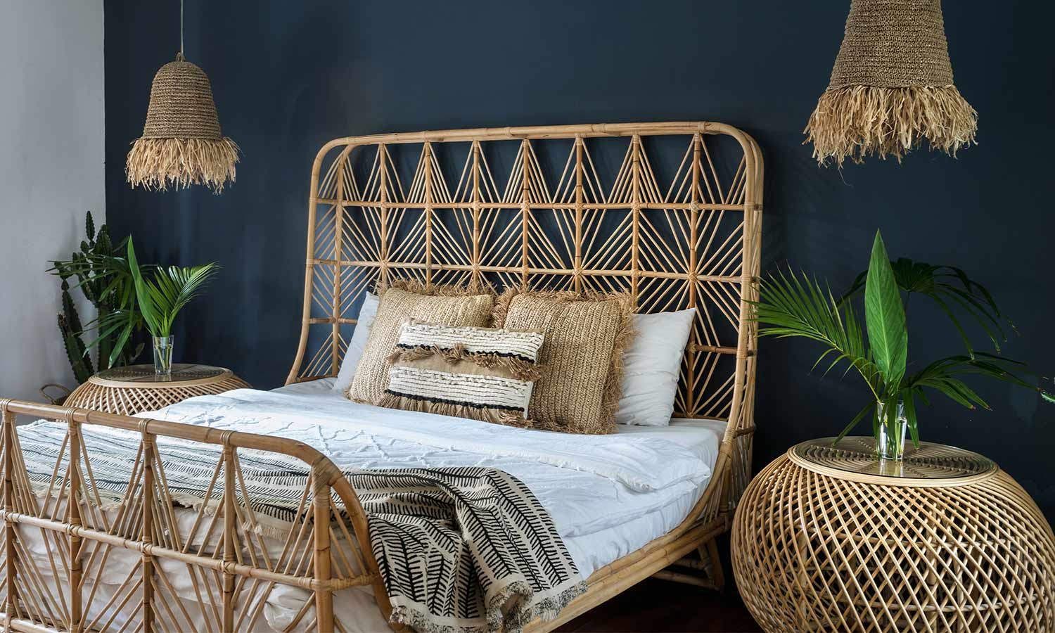 A light-colored bedframe with woven wicker in the headboard and footer.