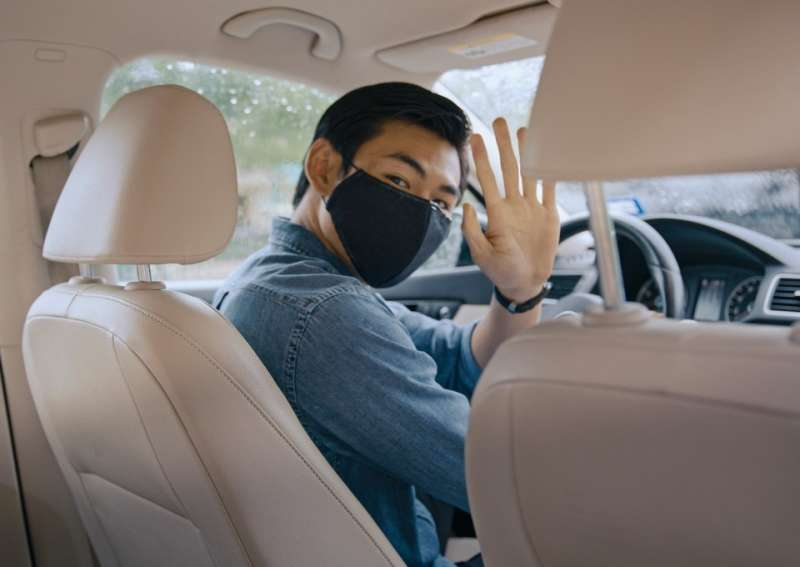 Driver wearing a mask in the car