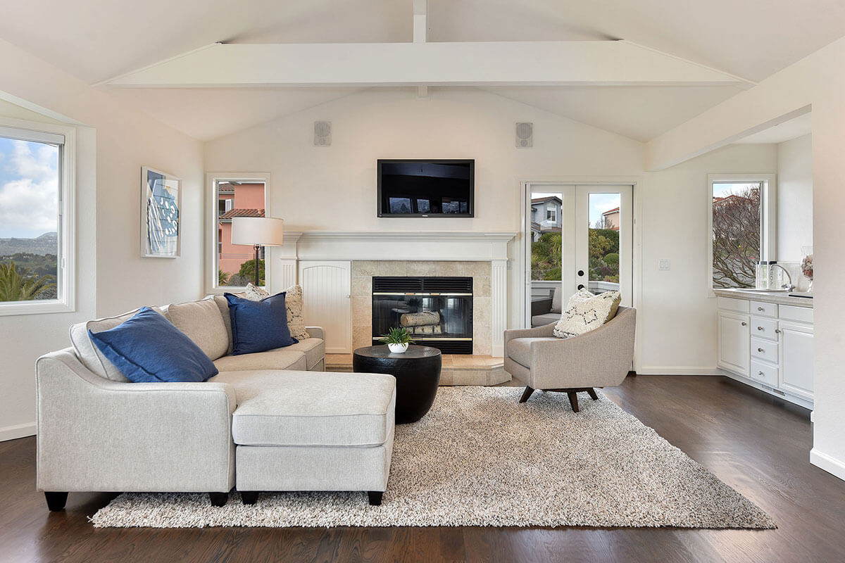 Updated, airy, elegant, bright, newly painted, and staged living room, after using concierge