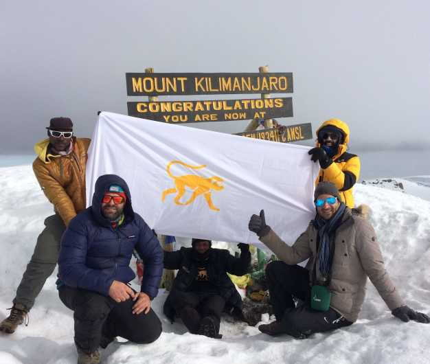 Trekkers celebrating after a successful summit to the highest point of Africa!