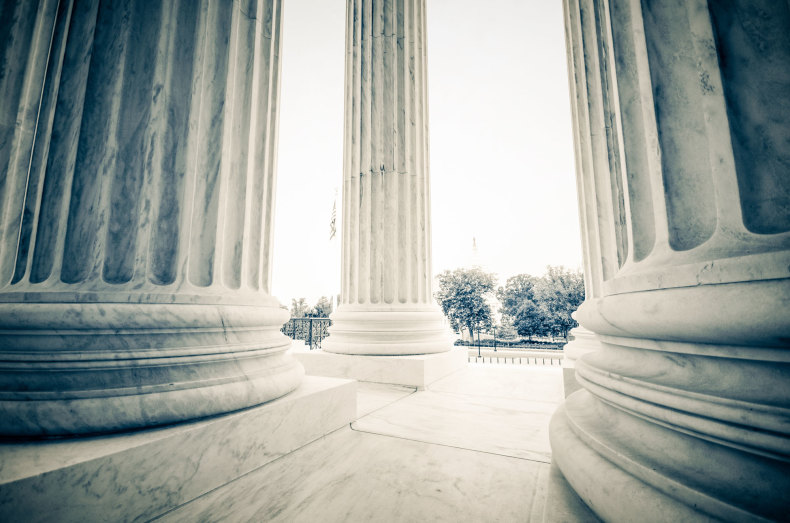 Looking out from inside the pillars in front of the U.S. Supreme Court.