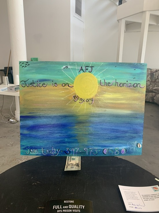 "Watercolor painting on canvas of the sun over water, with the words ""Justice is on the horizon"" under the acronym ""AFJ"""