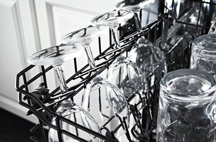 Top rack of dishwasher with spotless wine glasses