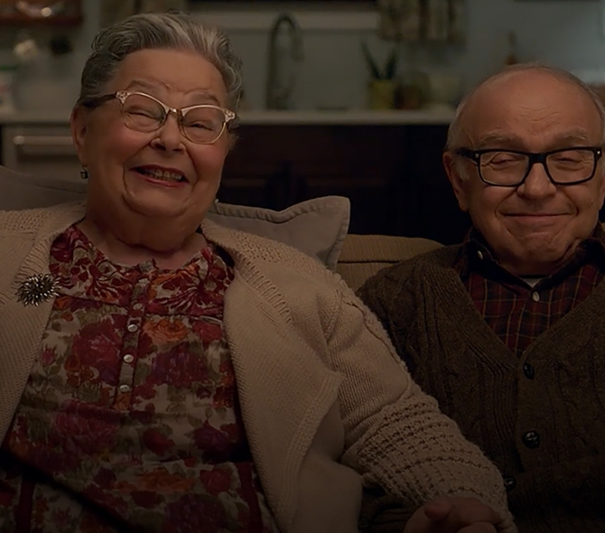 Senior adults sitting and smiling