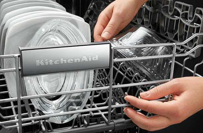 Taking out clean glassware from KitchenAid dishwasher