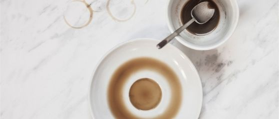 Coffee spill stains on white dishes