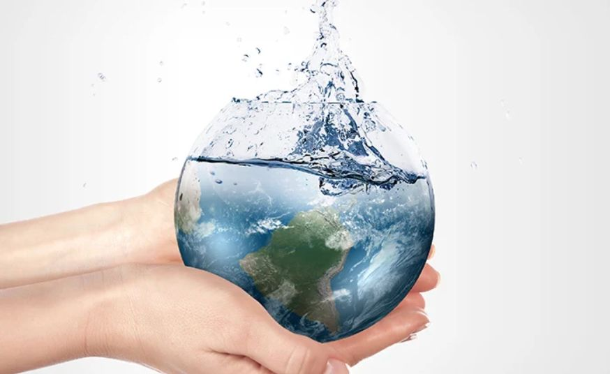 Hand holding sustainable earth globe