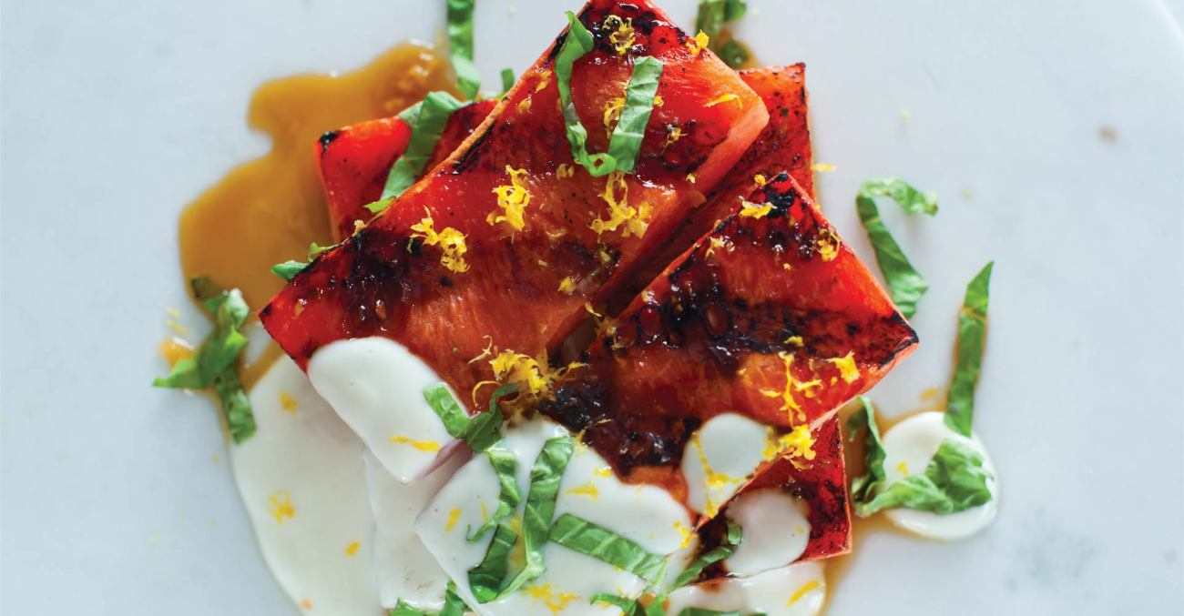 Grilled Watermelon with Lemon Zest, Basil, and Goat Cheese-Yogurt Sauce Recipe Primary Image