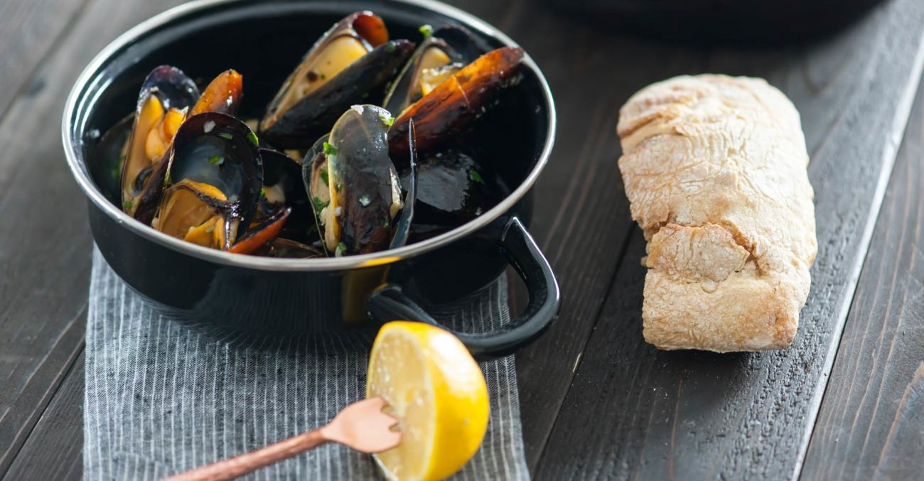 Oven-Roasted Mussels with Lemon, Garlic, and Wheat Beer Recipe Primary Image