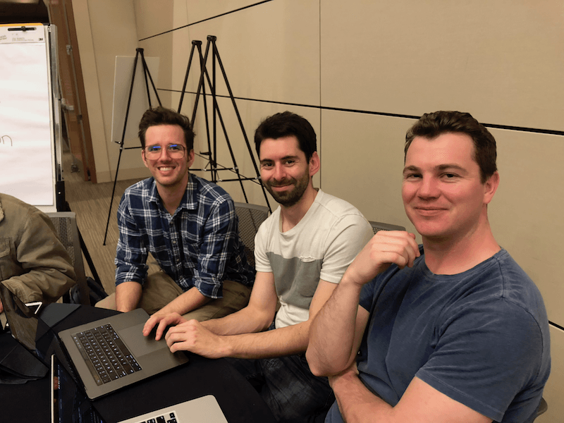 Rob, left, works with two other developers at the hackathon