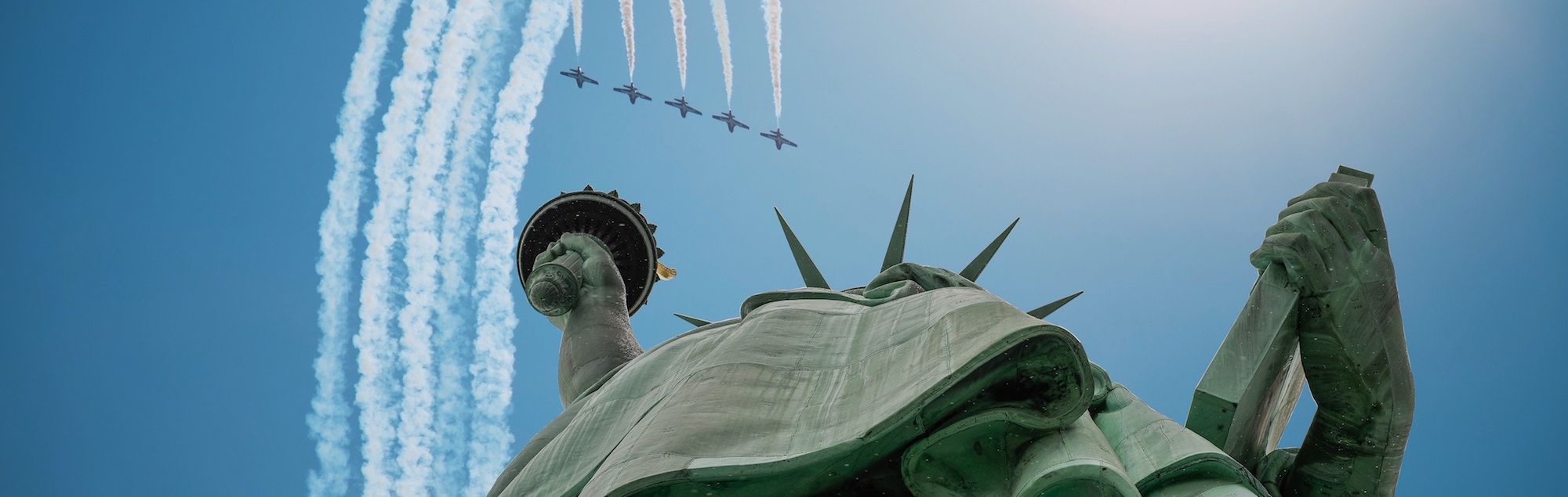 Planes flying over Statue of Liberty