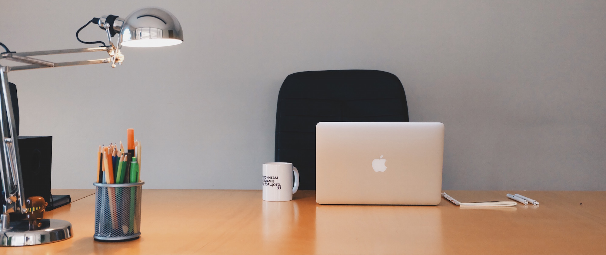 Desk with computer, lamp, and mug