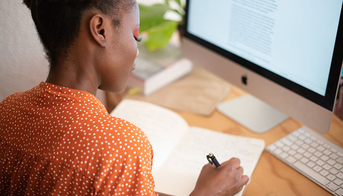 Image of a woman working on a business grant application
