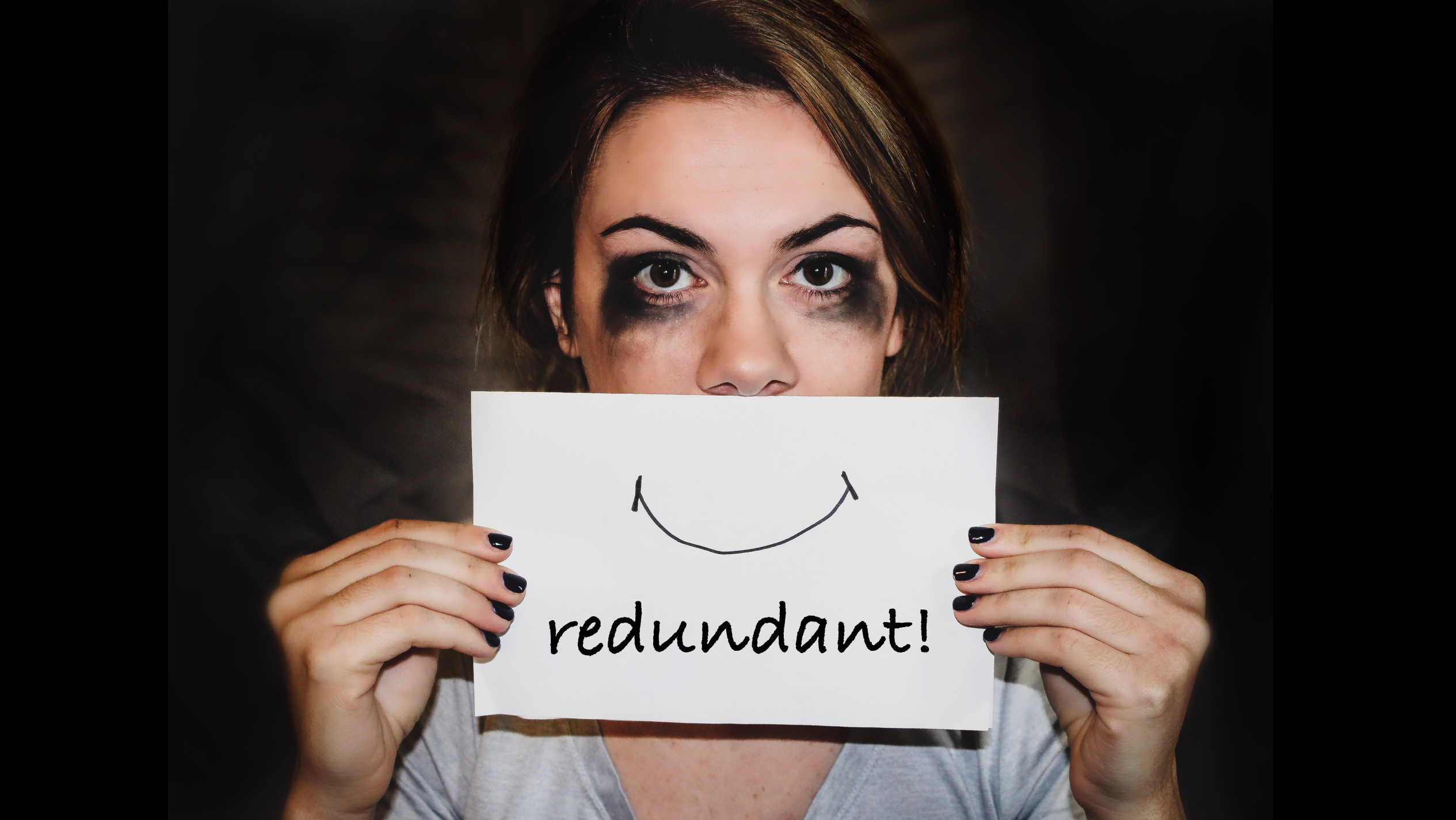 Redundant Smile sydney-sims-519706-unsplash