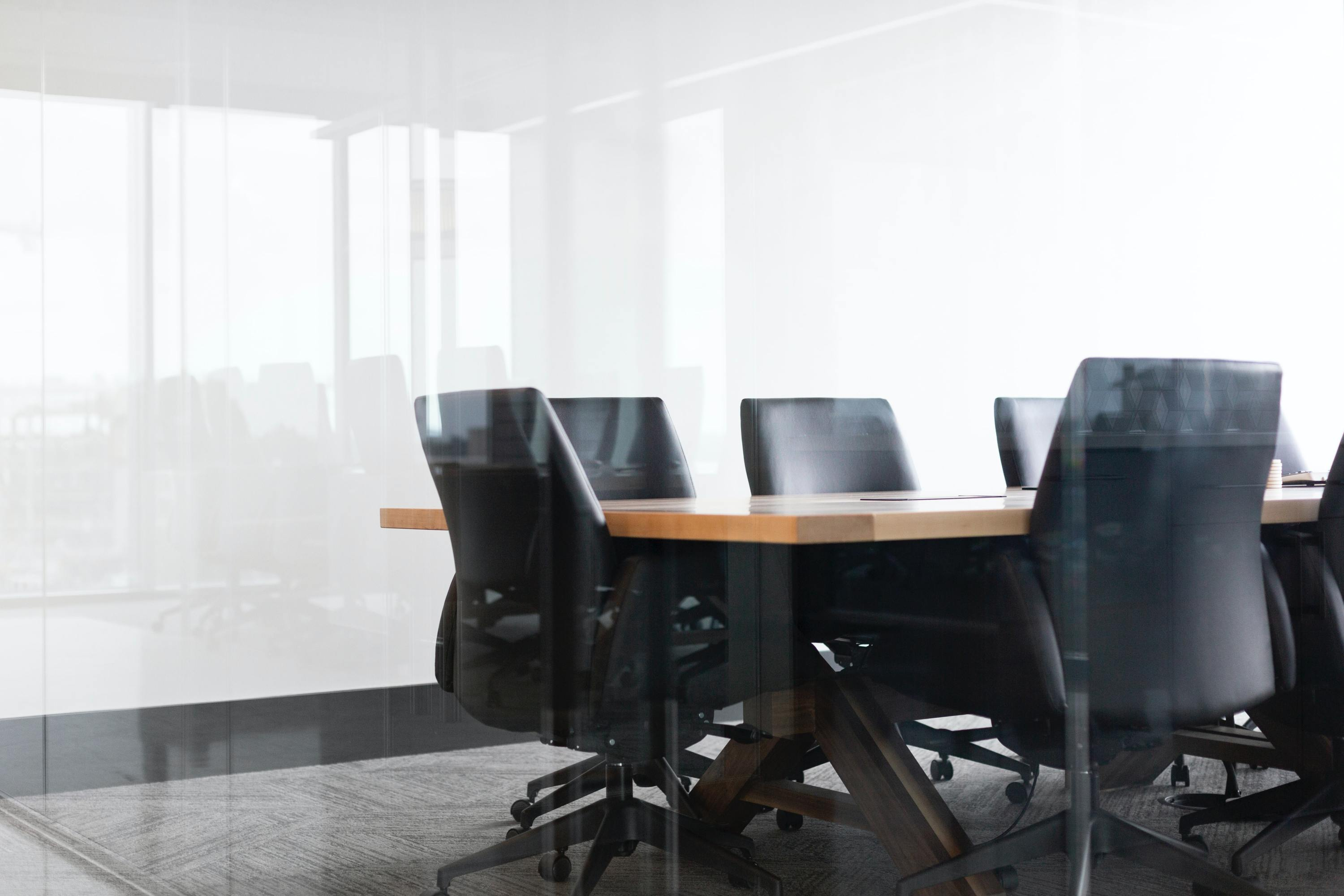 Empty Meeting Room drew-beamer-Se7vVKzYxTI-unsplash