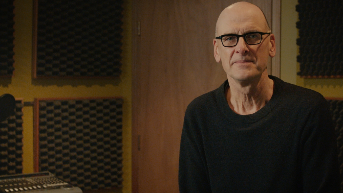 A photograph of author David Bergen in a recording studio