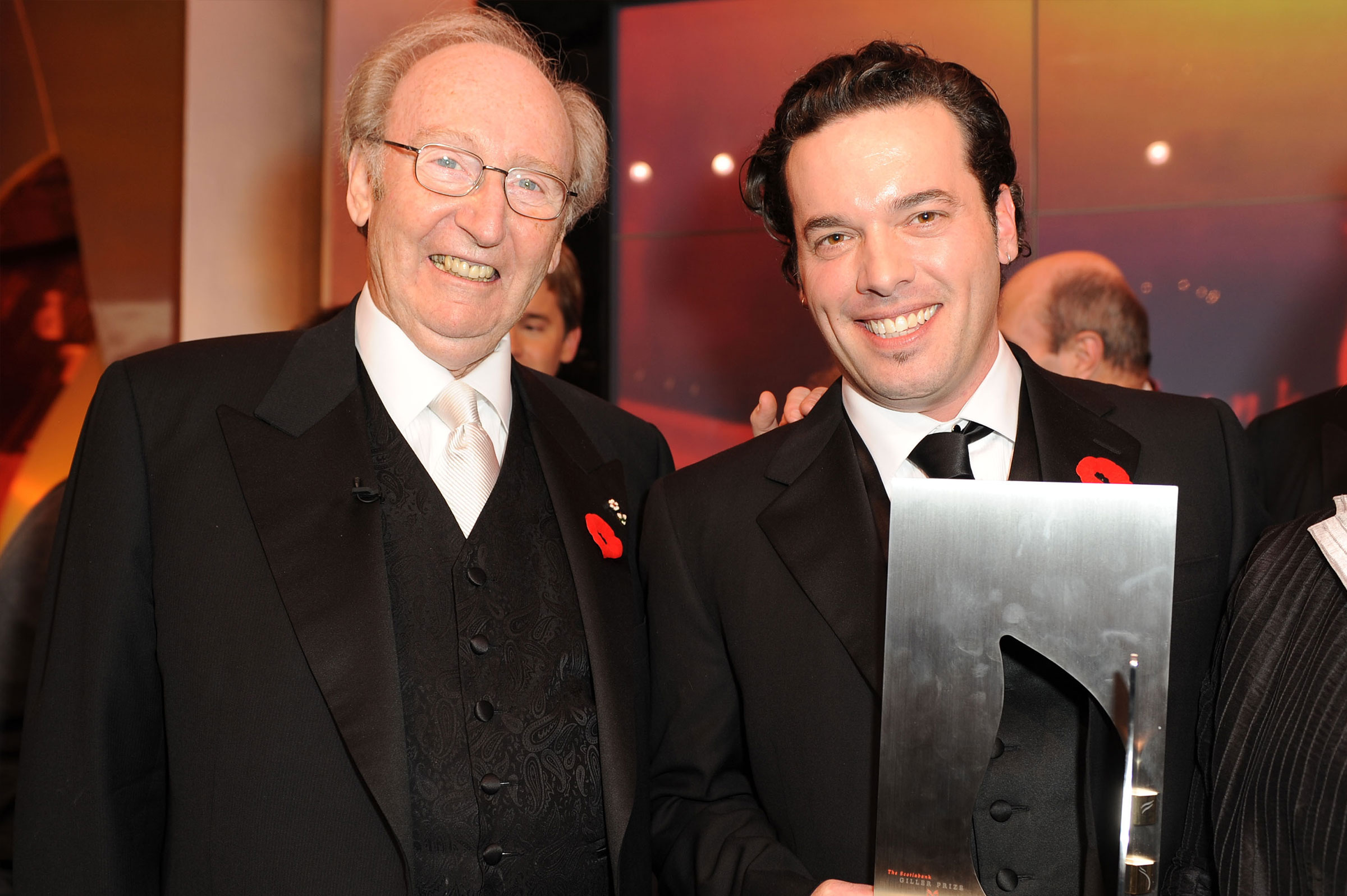 Picture of Joseph Boyden receiving the Giller Prize for his book Through Black Spruce