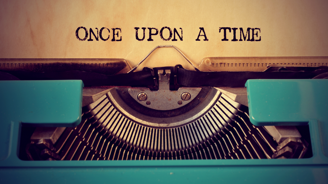 A piece of paper has been inserted into a typewriter and the text reads: Once Upon a Time