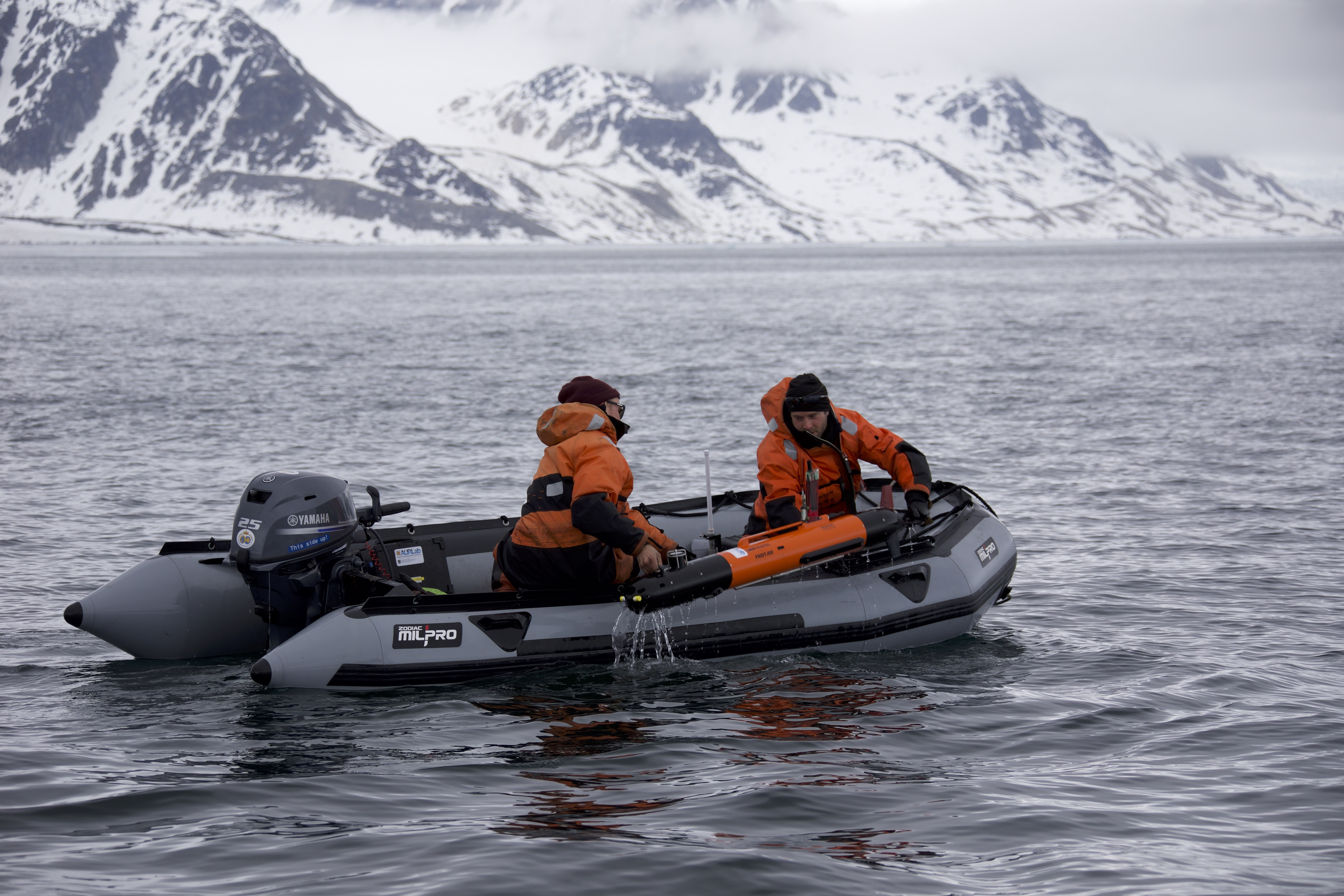 The scientists on the boat picking up the AUV