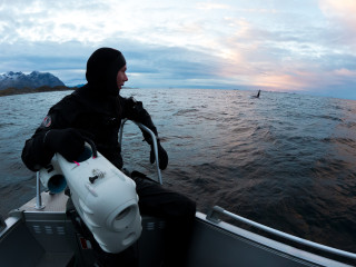 Jonas holding PioneerOne with male orca in background