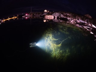 Night dive in the clear waters of Mausundvær