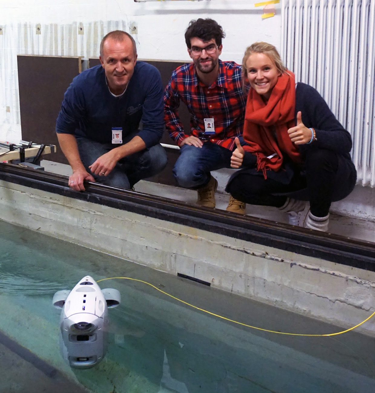 Erik, Borja and Christine with first Blueye prototype in the water