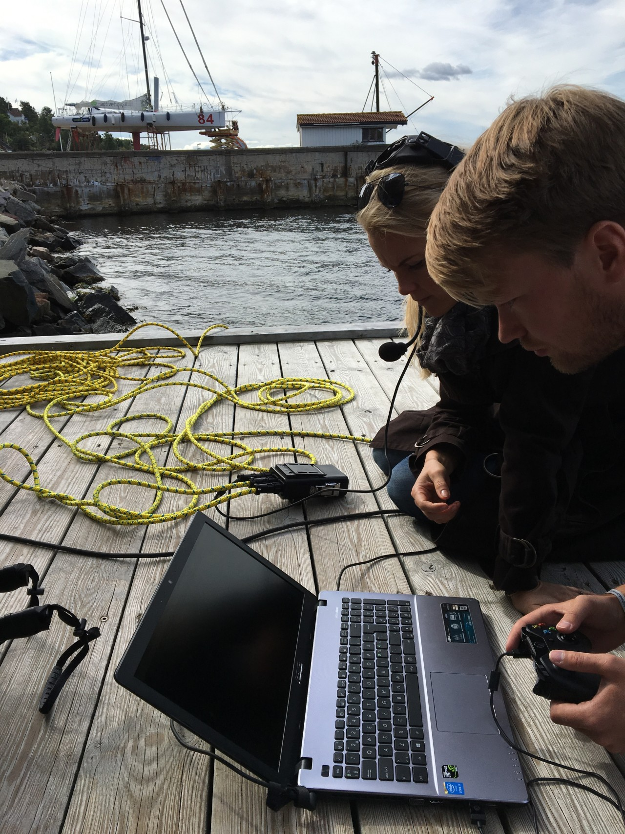 Andreas driving the drone with NRK's News Anchor,  watching closely to make a Live underwater interview.