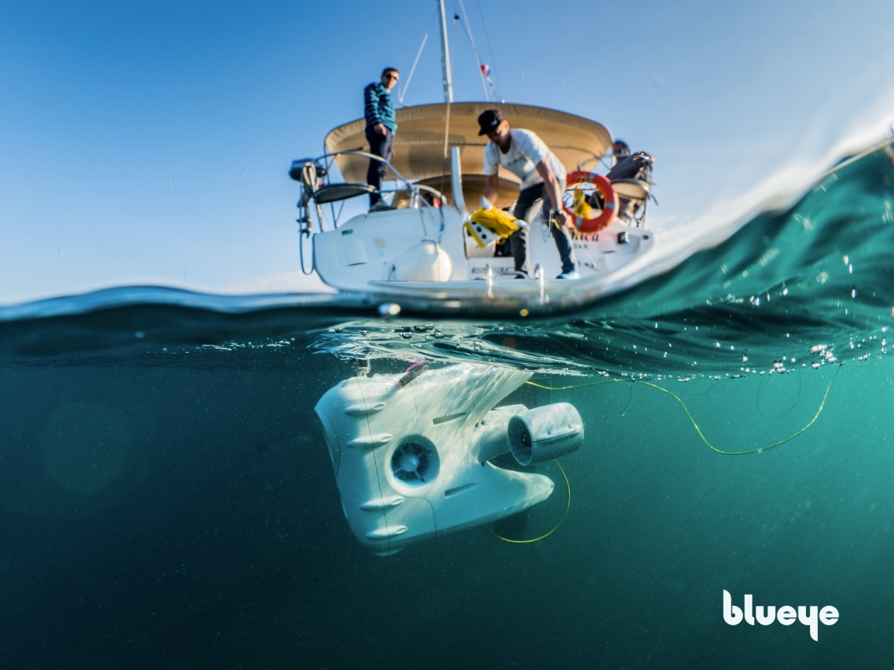 PioneerOne drone launched into the blue Adriatic sea from the back of a sailboat