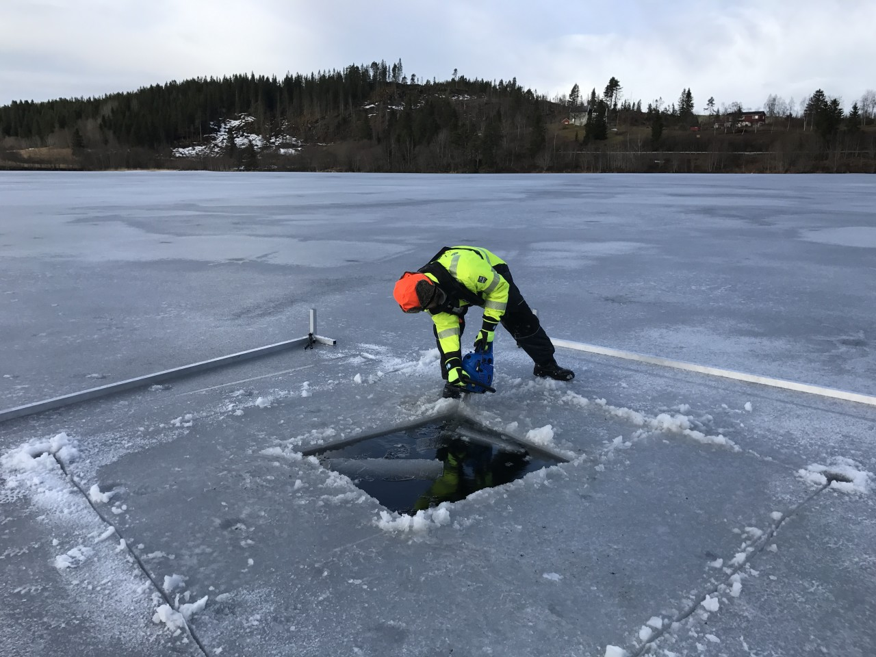 Making of the hole in the ice using chain saw