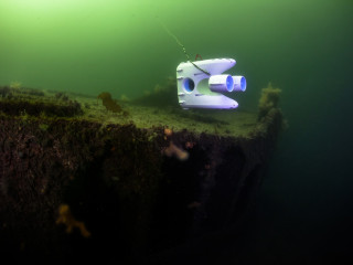 Exploring the Korsvika barge wreck in green plankton rich summer water