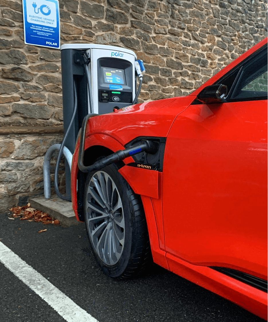 Red car charging on polar