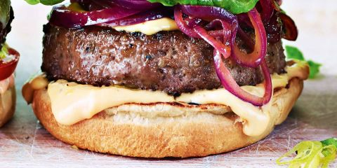 Beef rib burger with five cheese sauce and sticky onions