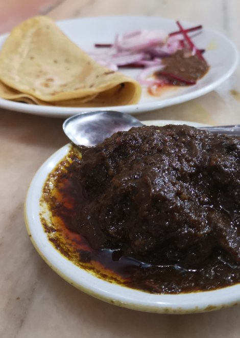 Mouth-watering mutton curry with freshly made chapattis