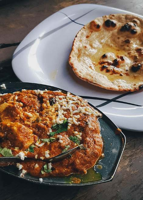 Try the best paneer curry and fresh buttery naans at this no name eatery