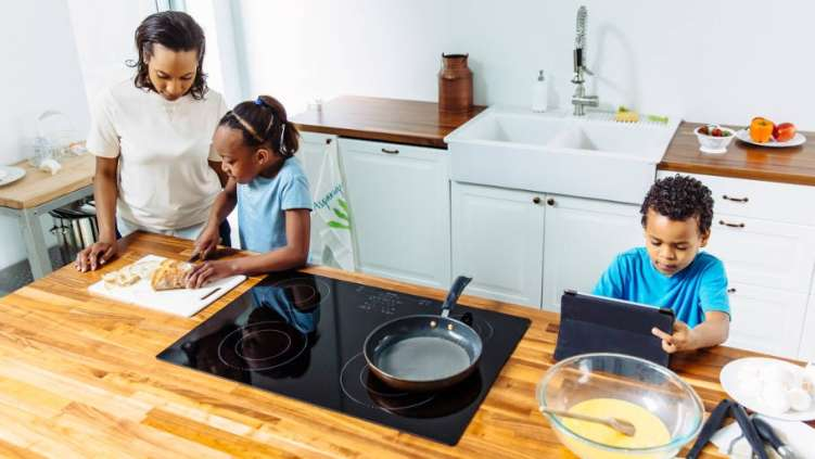 Mother cooking with son and daughter