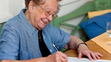 Older person writing