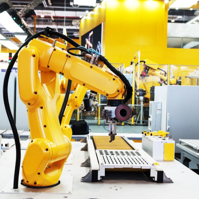 Large yellow robotic automation arm.
