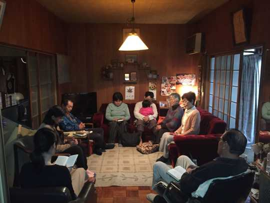 Praying together in the community of Nakagawa, Japan