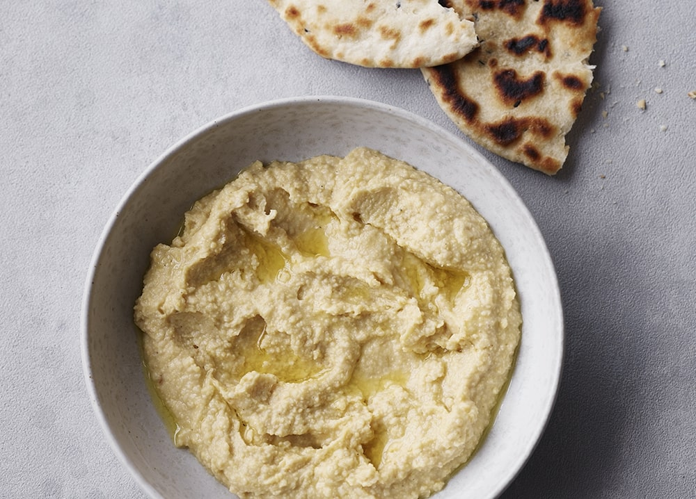 Bowl of hummus with flat bread