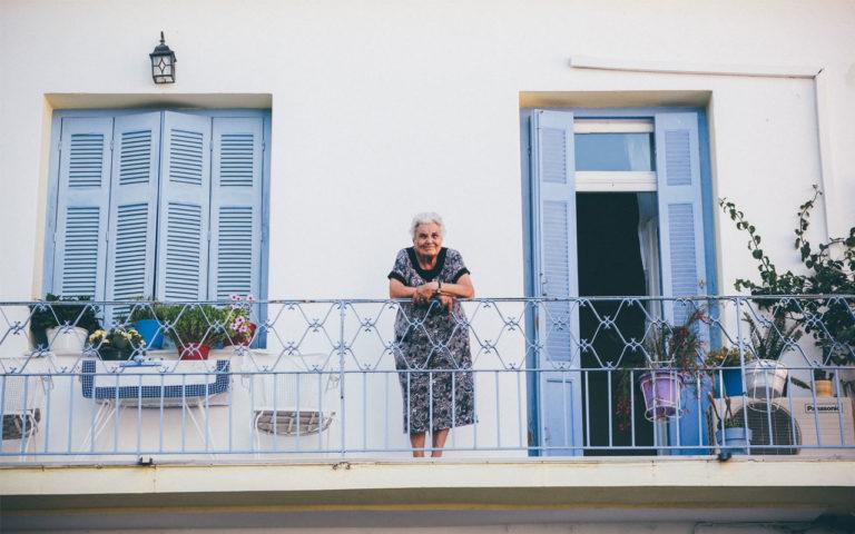 Older women on balcony leaning on railing