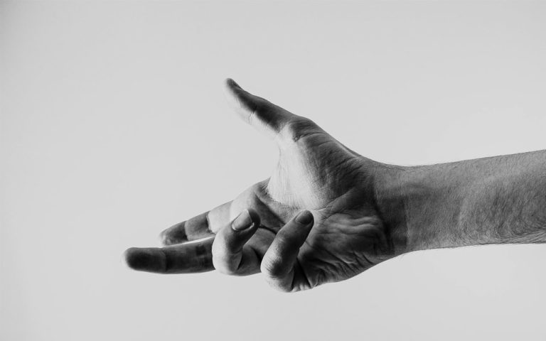 Black and white photo of hand reaching out