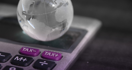 virtual image of a globe resting on a calculator