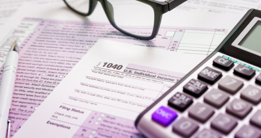 Eye glasses sitting on a 1040 tax form