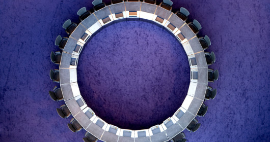 Circular boardroom table with chairs - overhead view