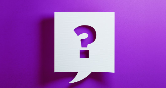 Question mark inside chat bubble