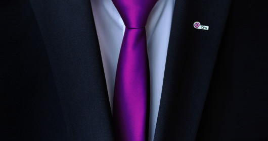 close up of suit with purple tie