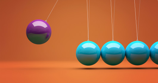 purple ball swinging into row of teal balls