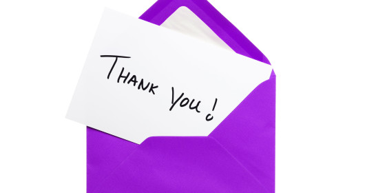 Purple envelope with thank-you card sticking out